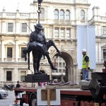 Statue lifted by crane in the courtyard of the Royal Academy